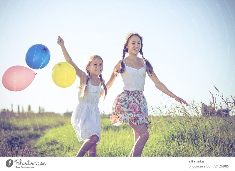 Happy little children playing in the field at the day time. Human being Child Nature Vacation & Travel Summer Sun Joy Lifestyle Meadow Family & Relations