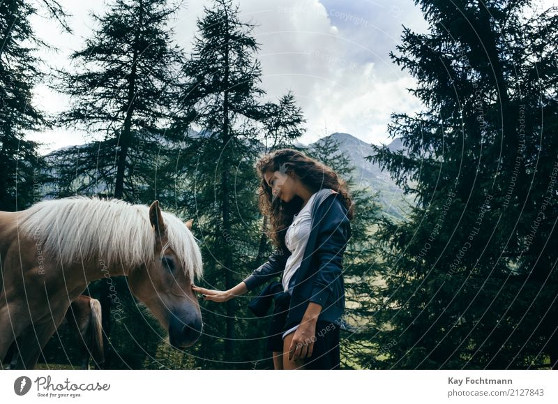 Young woman petting horse in the forest Vacation & Travel Adventure Freedom Summer Feminine Youth (Young adults) Life 1 Human being 18 - 30 years Adults