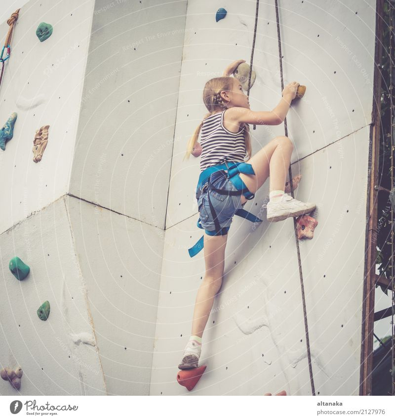 little girl climbing a rock wall outdoor. Joy Leisure and hobbies Playing Vacation & Travel Adventure Camping Entertainment Sports Climbing Mountaineering Child