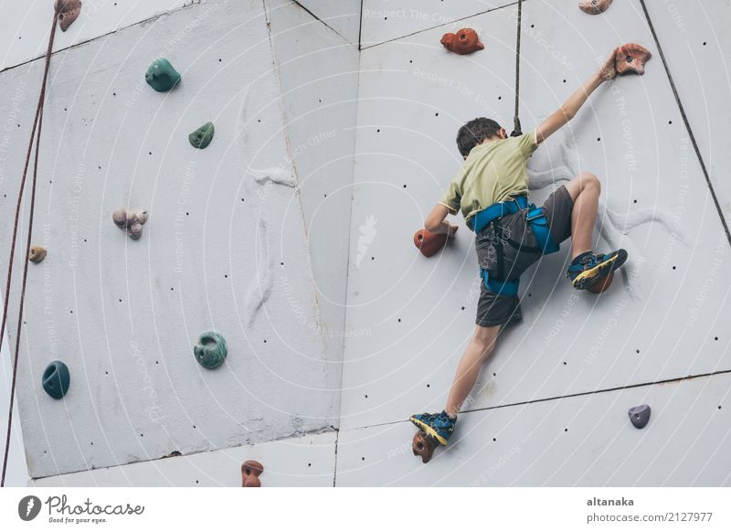 little boy climbing a rock wall outdoor. Joy Leisure and hobbies Playing Vacation & Travel Adventure Camping Entertainment Sports Climbing Mountaineering Child