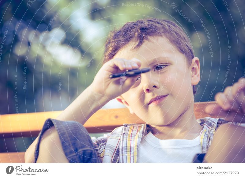 Happy little boy playing in the park at the day time. Human being Child Man Summer Beautiful Hand Relaxation Joy Face Adults Lifestyle Emotions Boy (child)