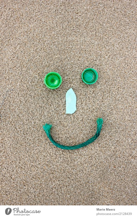 Recyling is good for the environment. Smiley figure made of plastic garbage. Sand Beach Make Happy Sustainability Green Virtuous Responsibility Help Inspiration