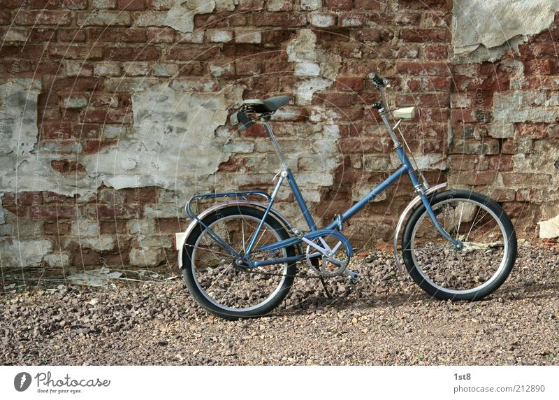 adaptive Means of transport Bicycle Old folded Folding bicycle folding wheel GDR mifa Colour photo Exterior shot Deserted Object photography Product photography