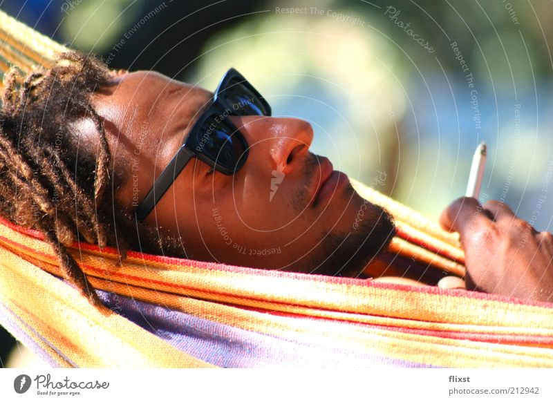 Just relax Masculine Man Adults Head 1 Human being 18 - 30 years Youth (Young adults) Sunglasses Black-haired Dreadlocks Relaxation Smoking Serene Colour photo