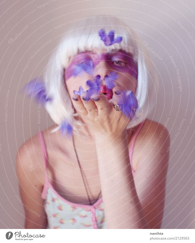 Artistic portrait of a woman blowing purple flowers Exotic Beautiful Make-up Wellness Senses Human being Feminine Young woman Youth (Young adults) 1