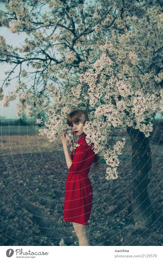 Young woman with red dress posing near a blossoming tree Elegant Style Harmonious Senses Relaxation Calm Fragrance Human being Feminine Youth (Young adults) 1