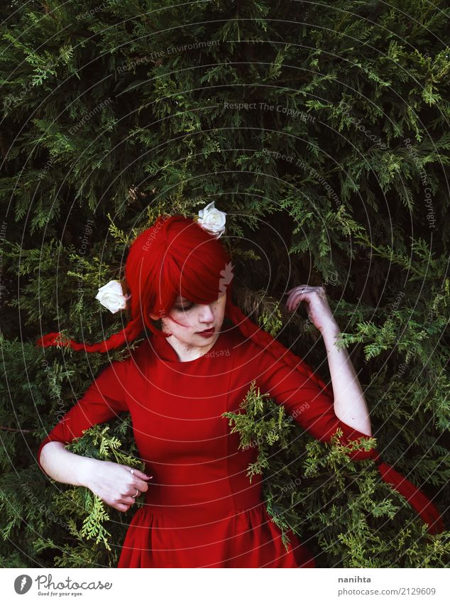 Young woman with red hair and red dress lying on leaves Human being Youth (Young adults) Colour Beautiful Green Flower Red Loneliness Leaf 18 - 30 years Adults