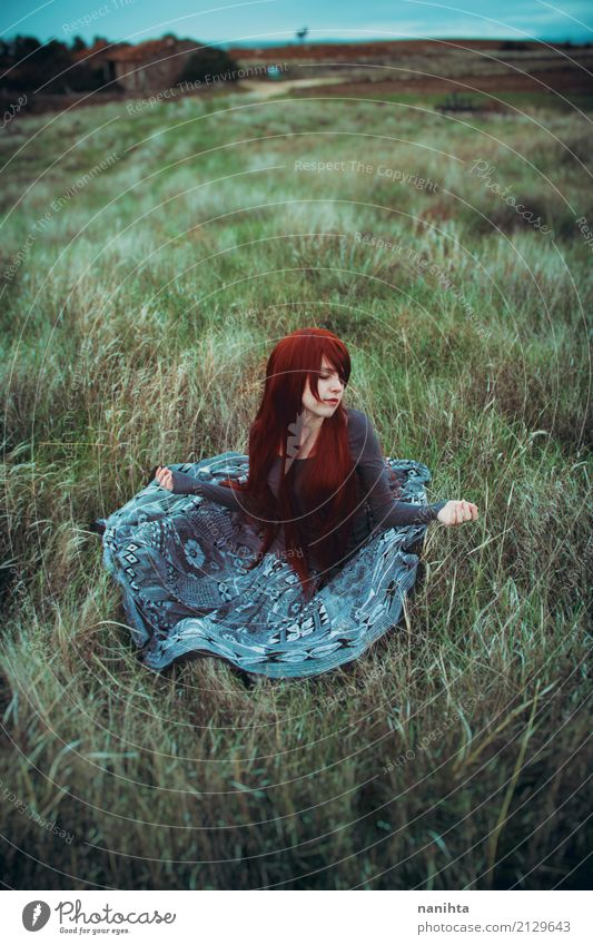 Young redhead woman sitting in a field Human being Feminine Young woman Youth (Young adults) 1 18 - 30 years Adults Environment Nature Landscape Spring Autumn