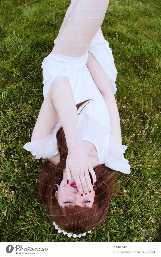 Young woman lying down in a field of grass Lifestyle Elegant Style Beautiful Human being Feminine Youth (Young adults) 1 18 - 30 years Adults Nature Plant