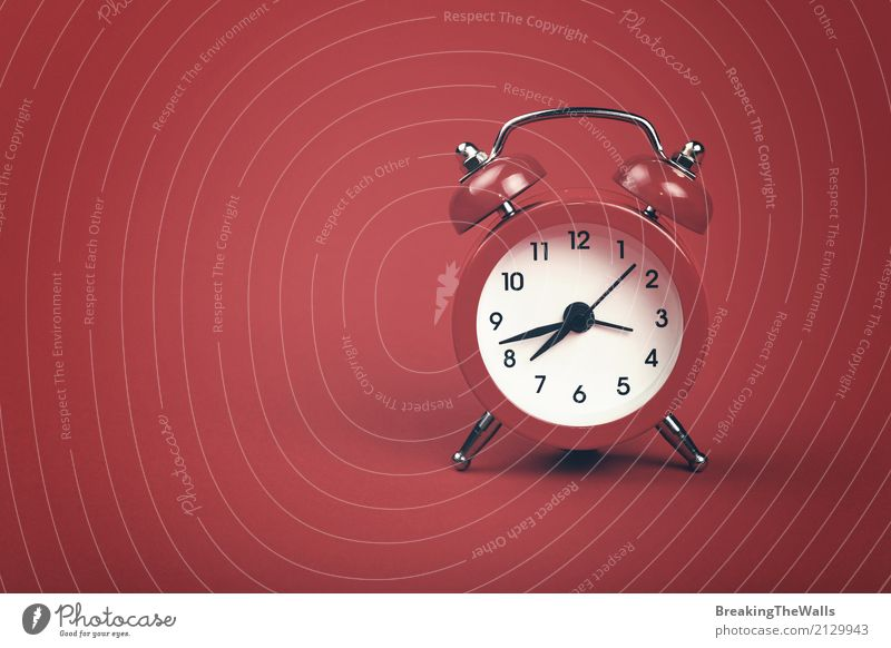 Retro alarm clock with bells over red paper background Lifestyle Clock Metal Old Sleep Red Tradition Conceptual design Bell Warn Vantage point Wake 1 Sign Time