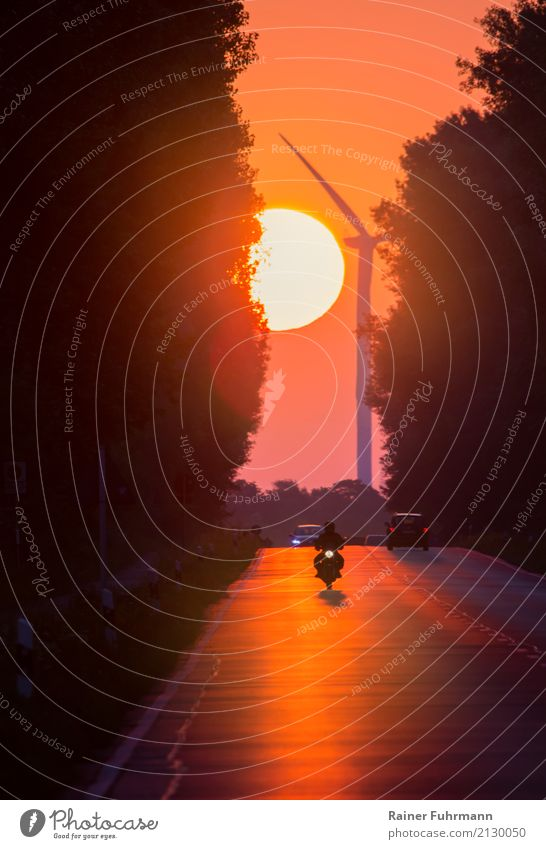 a sunrise on a country road with vehicle traffic Environment Landscape Sun Sunrise Sunset Weather Beautiful weather Transport Means of transport