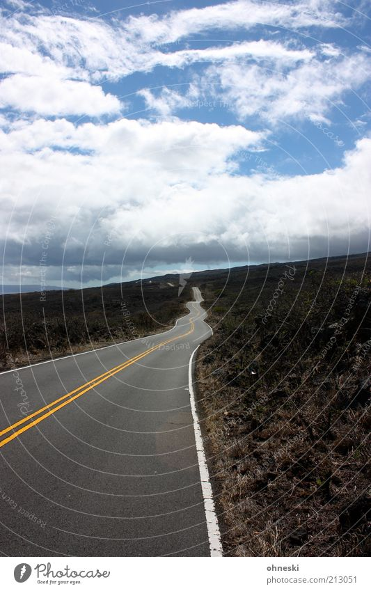 road construction Landscape Earth Sky Clouds Maui Transport Traffic infrastructure Street Lanes & trails Far-off places Curve Undulating Colour photo Target