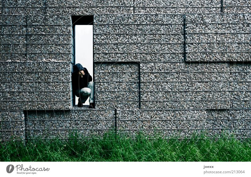 THE OTHER SIDE Man Adults 1 Human being Meadow Wall (barrier) Wall (building) Think Sadness Cry Sharp-edged Gloomy Gray Green Emotions Protection Grief Pain