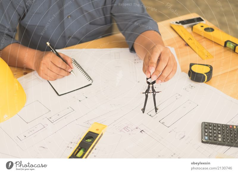 Architect or planner working on drawings for construction plans Design Desk Work and employment Profession Office Business Meeting Computer Notebook Technology