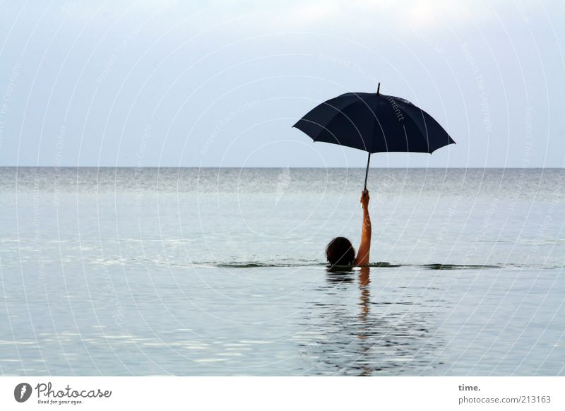 precautionary measure Swimming & Bathing Far-off places Ocean Waves Woman Adults Head Arm Water Sky Horizon Baltic Sea Umbrella Exceptional Wet Black Whimsical