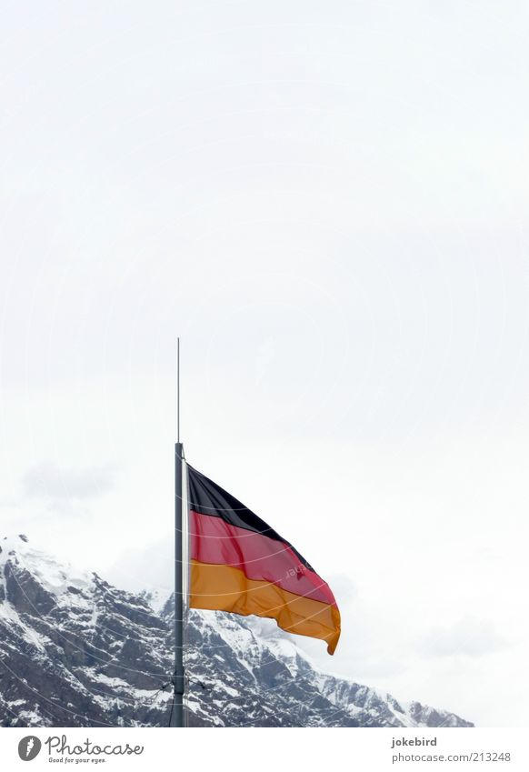 Germany is (mountain)abolishing itself? Sky Winter Snow Rock Alps Mountain Peak Snowcapped peak Flag Cold Ice Covered Clouds German Flag Wind White Kyrgyzstan