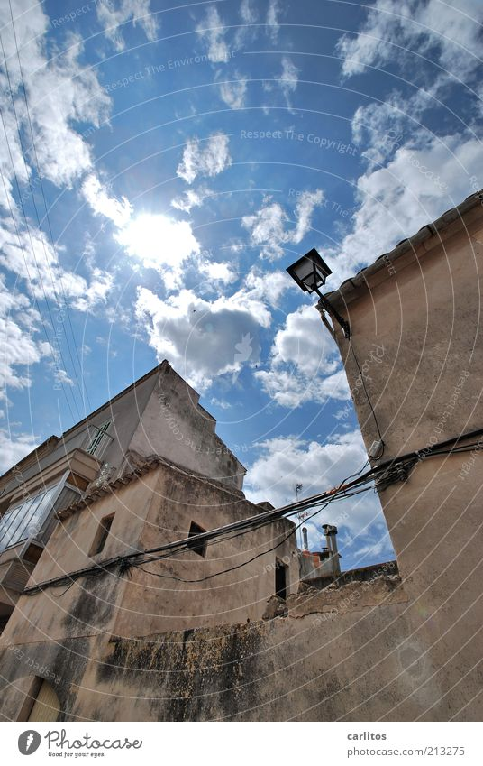 Everything crooked and crooked Sky Clouds Sun Summer Beautiful weather Small Town Old town House (Residential Structure) Wall (barrier) Wall (building) Facade
