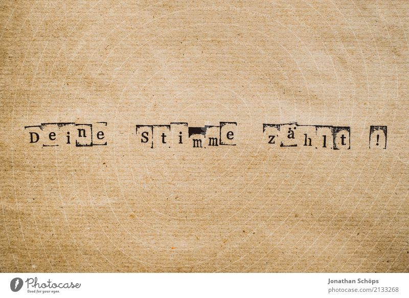 Your vote counts as a stamp on wrapping paper, for the federal election 2021 Resolve Text Select Elections Decide Indecisive Typography Characters Wood Stamp
