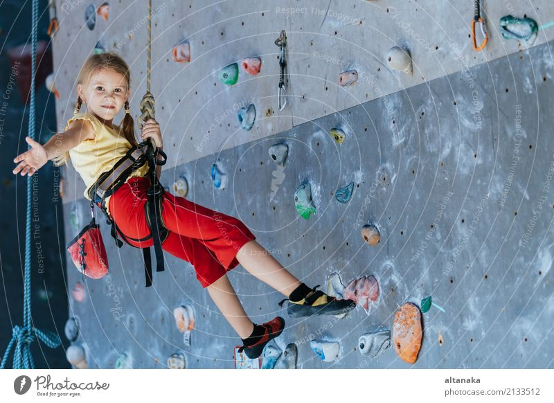 little girl climbing a rock wall indoor. Human being Child Woman Vacation & Travel Hand Joy Adults Sports Playing Rock Leisure and hobbies Park Action Adventure