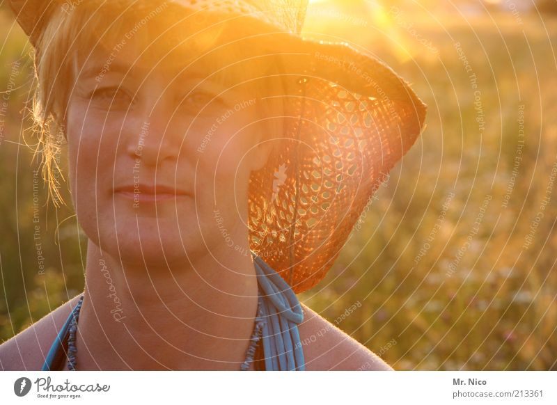 just a day Summer vacation Feminine Woman Adults Head Face Nature Beautiful weather Wild plant Meadow Hat Blonde Natural Warmth Sunhat Straw hat Twilight