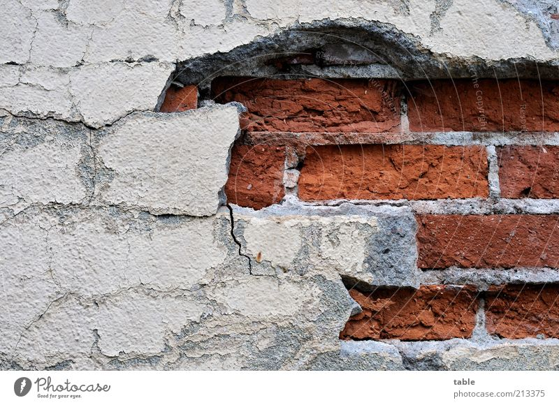 breakup Wall (barrier) Wall (building) Facade Stone Concrete Old Sharp-edged Broken Gray Red Apocalyptic sentiment Decline Past Transience Plaster
