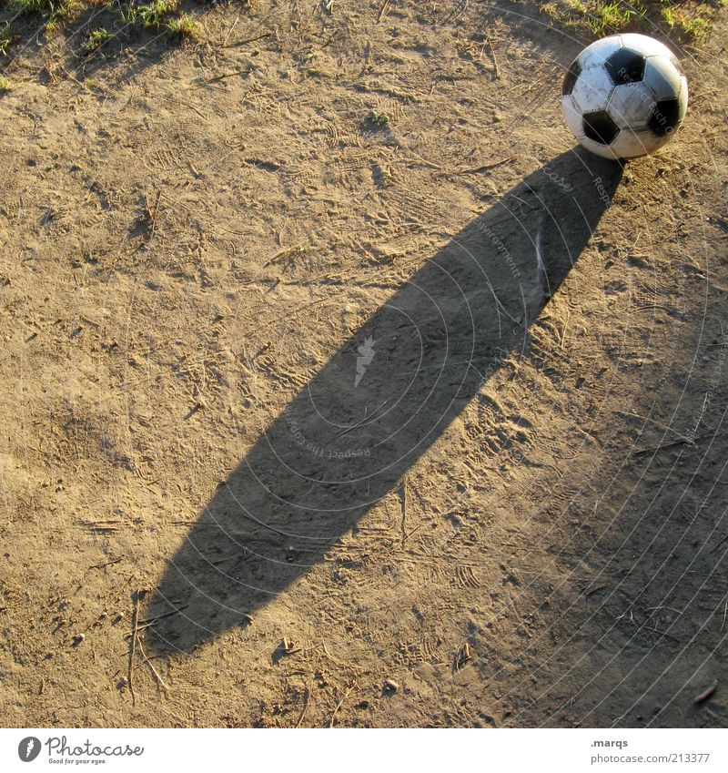 futbol Leisure and hobbies Sports Loser Foot ball Earth Sign Sphere Playing Dirty Positive Joy Colour photo Exterior shot Copy Space left Copy Space bottom