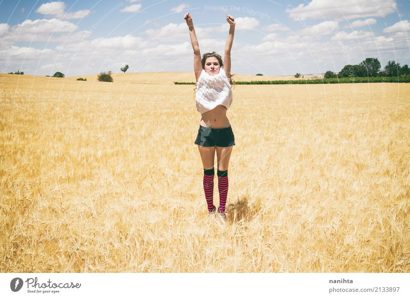 Young woman jumping in a field of wheat Lifestyle Joy Wellness Vacation & Travel Summer Summer vacation Sun Success Human being Feminine Youth (Young adults) 1