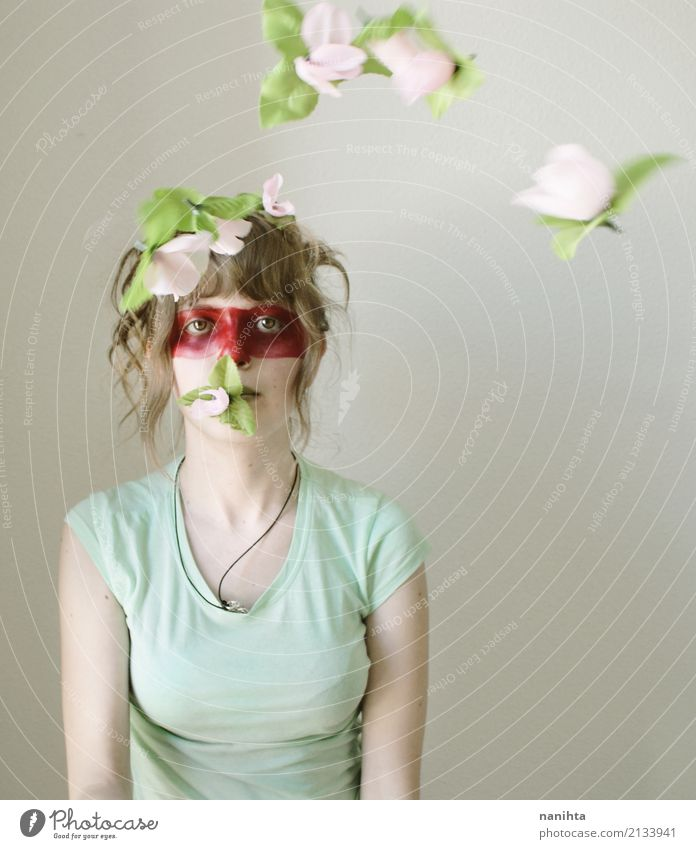 Creative portrait of a young woman and flying flowers Human being Youth (Young adults) Green Young man Flower Red 18 - 30 years Face Adults Feminine Art