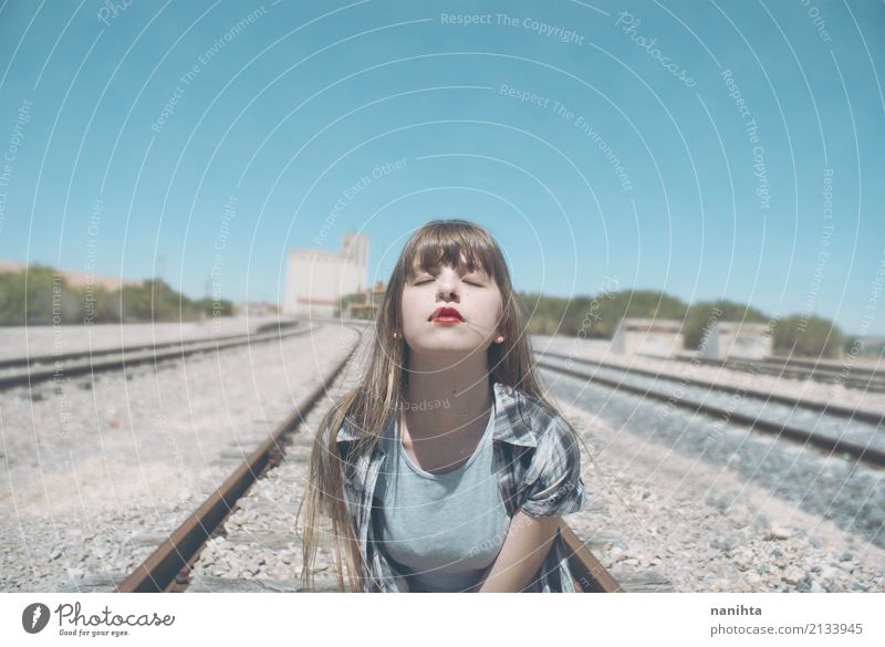 Young woman breathing in a railway road Lifestyle Human being Feminine Youth (Young adults) 1 18 - 30 years Adults Sky Rail transport Railroad Blonde