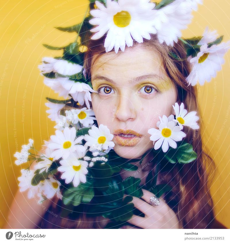 Artistic portrait of a young woman with a lot of daisies Human being Youth (Young adults) Young woman Beautiful White Flower 18 - 30 years Face Adults Yellow