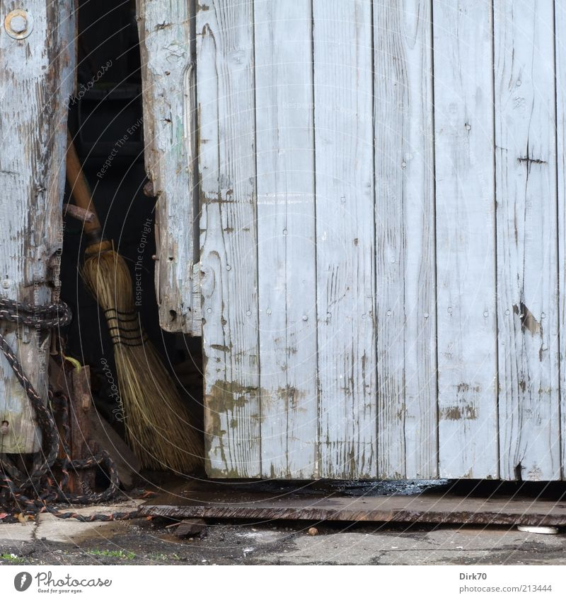 Broom parked Manmade structures Building Storage shed Door Wood Entrance Main gate Access Dirty Dark Simple Blue Gray Disregard Calm Stagnating Moody Decline