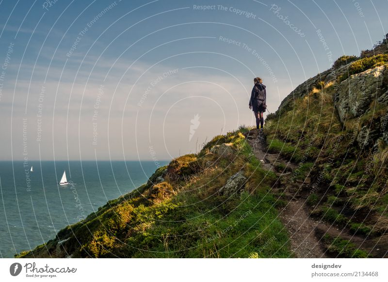 Young woman looks lonely at the sea with sailing boats Vacation & Travel Tourism Far-off places Freedom Ocean Island Hiking Feminine Youth (Young adults) 1