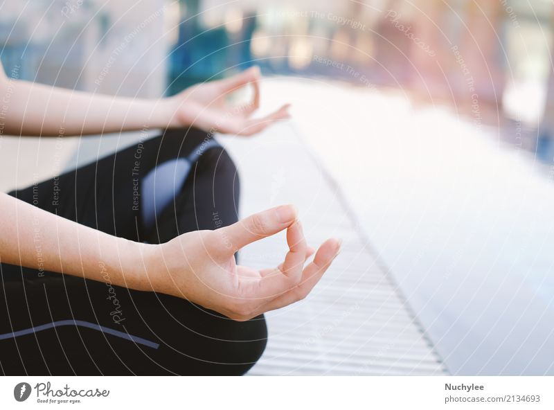 Woman meditating in the lotus position Hand Relaxation Adults Lifestyle Health care Copy Space Leisure and hobbies Sit Action Fingers Energy Wellness Posture