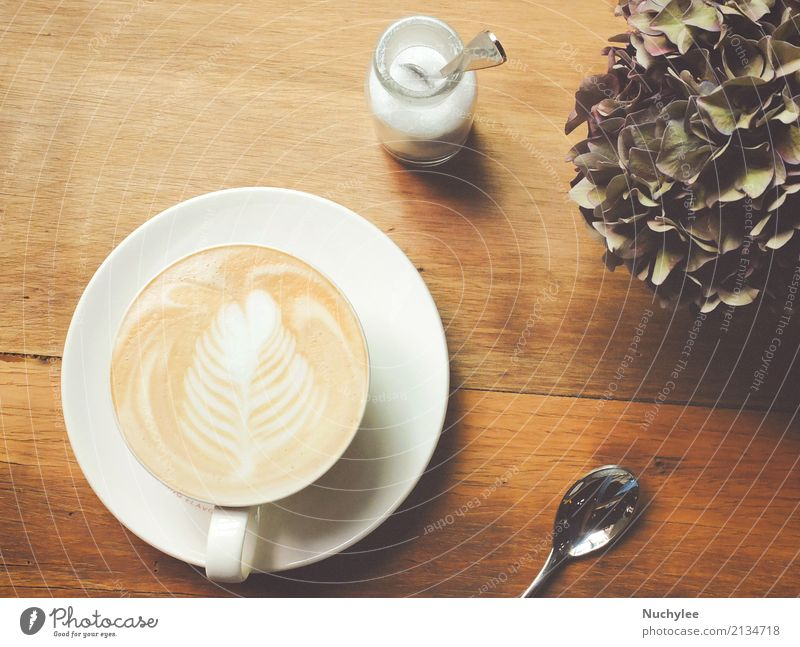 Cappuccino or latte coffee on table Breakfast Lunch Beverage Coffee Espresso Plate Spoon Design Leisure and hobbies Table Restaurant Art Plant Flower Fresh Hot