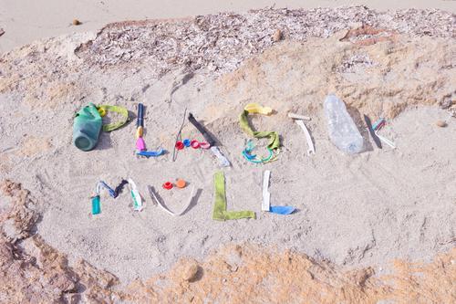 Ocean Beach Environment Coast Sand Dirty Characters Plastic Trash Word Environmental protection Text Packaging Environmental pollution Plastic packaging
