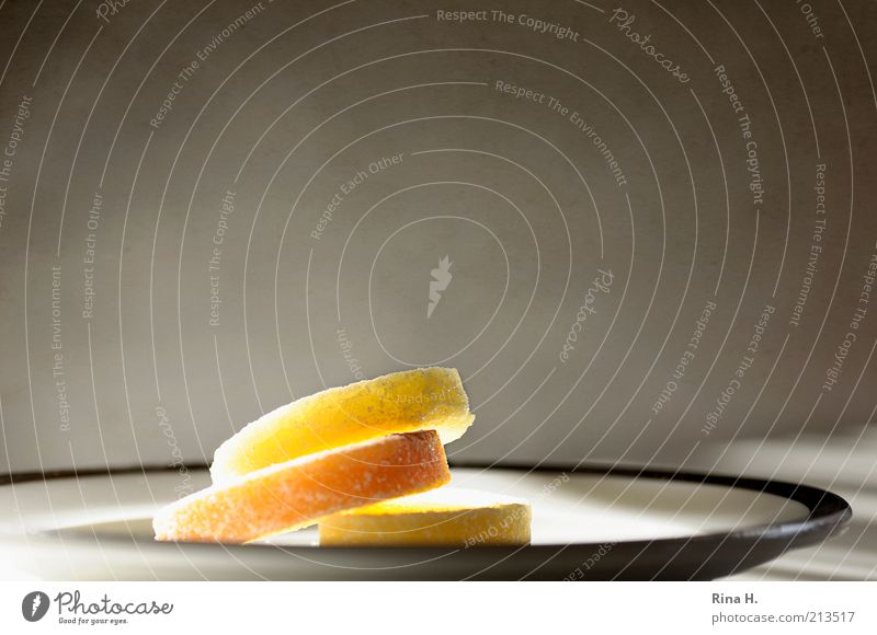 Light Sweets Candy Nutrition Plate Illuminate Bright Delicious Yellow Gold To enjoy Colour photo Copy Space left Copy Space right Copy Space top
