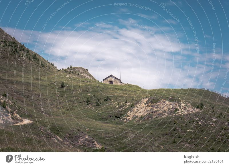 mountain hut Mountaineering Hiking Climbing Environment Nature Landscape Grass Alps Blue Brown Green Loneliness Colour photo Exterior shot Copy Space top Day