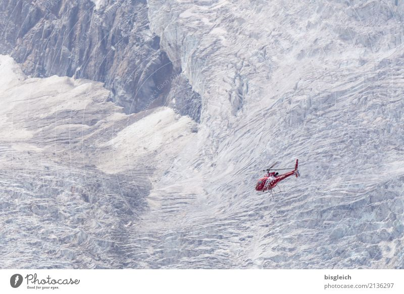 helicopters Alps Mountain Glacier Zermatt Switzerland Europe Helicopter Flying Gray Red White Bravery Help Hope Cold Colour photo Exterior shot Deserted