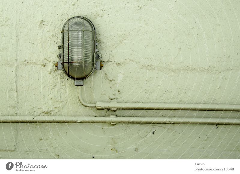 Lamp Wall (building) Wall (barrier) Bright Lighting Facade Electricity Gloomy Cable Iron-pipe Plaster