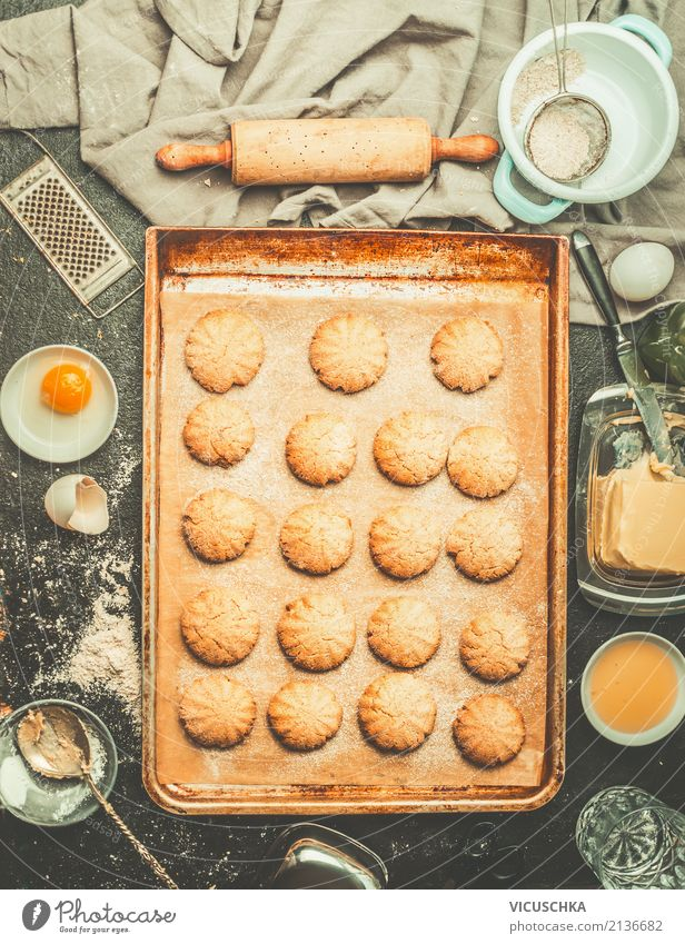 Biscuits on baking tray with ingredients and dough roller Food Dough Baked goods Cake Dessert Nutrition Crockery Style Design Winter Living or residing Table