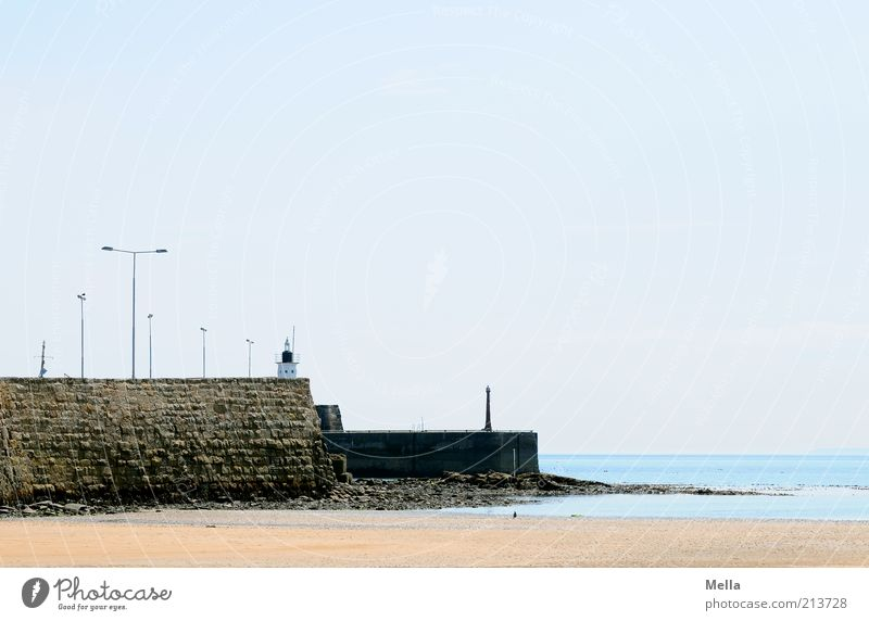 deserted Vacation & Travel Trip Beach Ocean Environment Landscape Sand Water Cloudless sky Beautiful weather Coast Mole Wall (barrier) Wall (building) Lamp