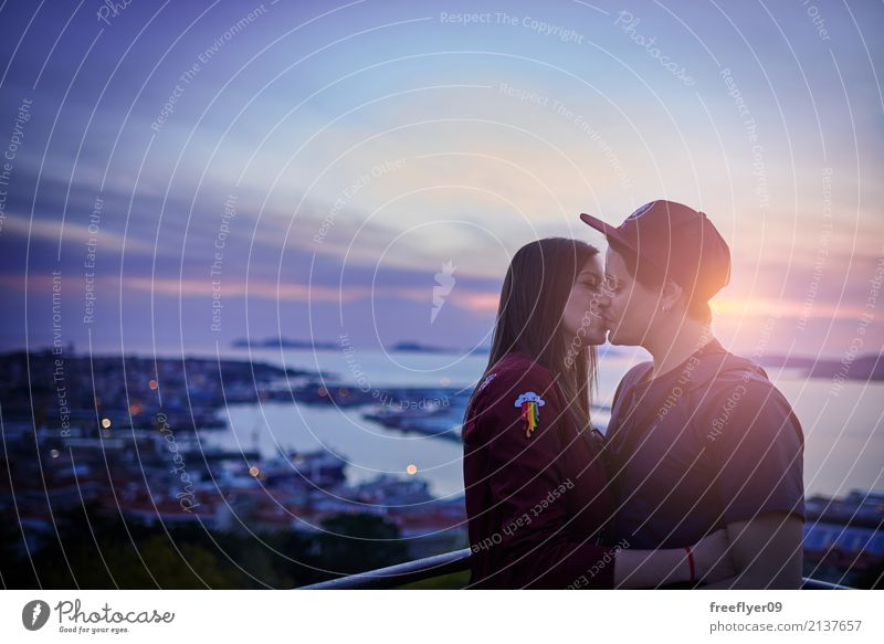 Couple kissing at sunset Human being Sky Nature Vacation & Travel Youth (Young adults) Young woman Summer Water Young man Landscape Ocean Clouds 18 - 30 years