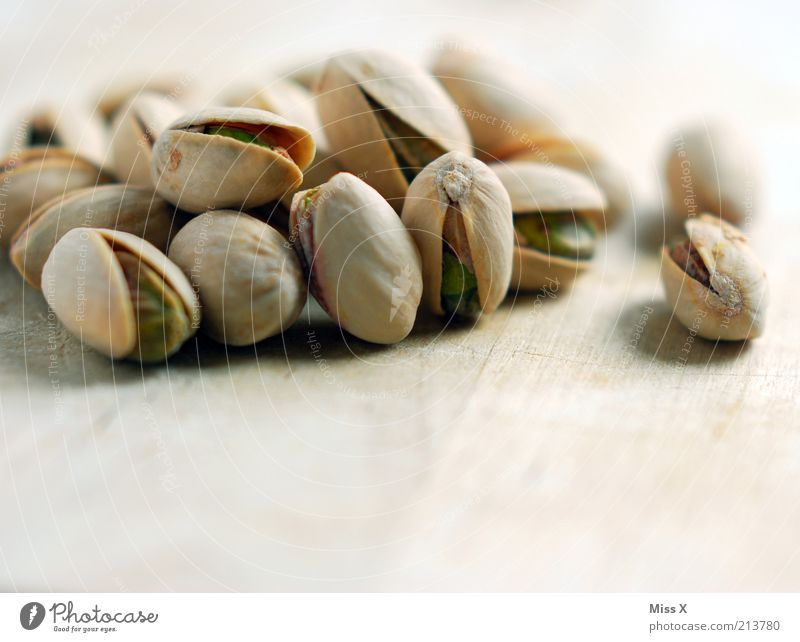 pistachios Food Nutrition Organic produce Vegetarian diet Small Delicious Round Dry Salty Pistachio Kernels & Pits & Stones Nibbles Snack Sheath Colour photo