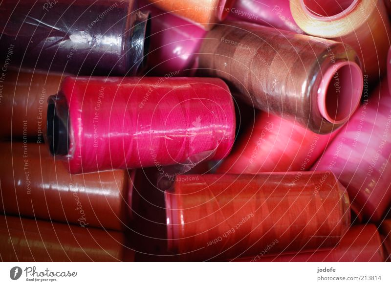 sewing thread Kitsch Odds and ends Pink Red Sewing thread Colour Packaged Plastic Glittering sewing thread reels Gaudy Colour photo Multicoloured Exterior shot