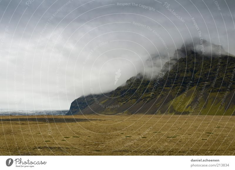 Nature Sky Vacation & Travel Clouds Far-off places Dark Mountain Rain Landscape Wind Climate Gale Iceland Nordic Bad weather Storm clouds