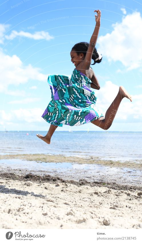 Float over the beach in a party mood. Feminine Girl 1 Human being Sand Coast Beach Baltic Sea Dress Black-haired Long-haired Flying Jump Beautiful Joy