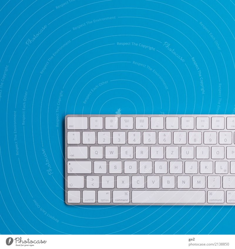 Keyboard on blue School Professional training Academic studies Work and employment Office work Workplace Media industry Advertising Industry Business Company