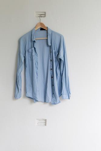 hang out Living or residing Flat (apartment) Room Wall (barrier) Wall (building) Balcony Fashion Shirt Cloth Hanger Blue Dry Vent slot Colour photo
