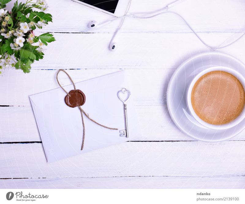 Cup of coffee Breakfast To have a coffee Hot drink Coffee Mug Telephone PDA Flower Blossoming Eating Above envelope seal key Bud Top cup Headphones Colour photo