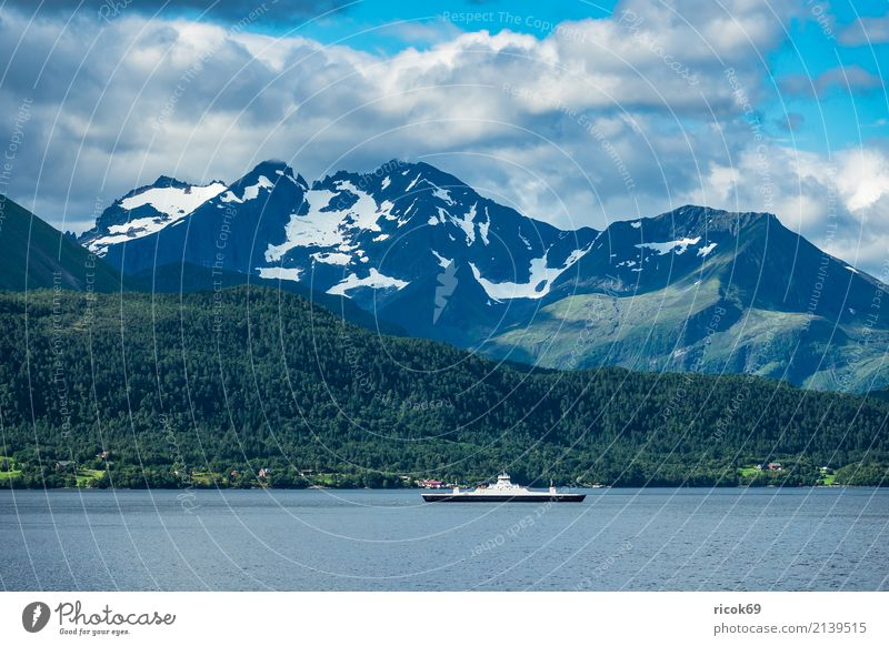 View of the Storfjord in Norway Relaxation Vacation & Travel Tourism Mountain Nature Landscape Water Clouds Rock Fjord Tourist Attraction Ferry Watercraft Idyll